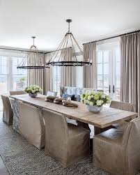 light salvaged wood trestle dining table with rope and iron ring chandeliers