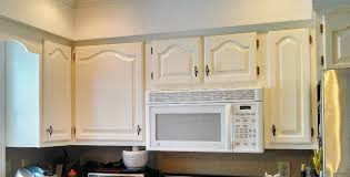 oak cabinets painted whiteWhite Kitchen Cabinets Refinishing After Oak Cabinets and