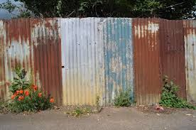 Painted Fences painted corrugated metal fence home & gardens geek 3394 by xevi.us