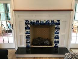 victorian fireplace with william de morgan blue and white ships north kingston ri