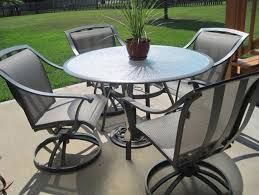 black wrought iron patio furniture with 4 swivel patio chairs and small round table