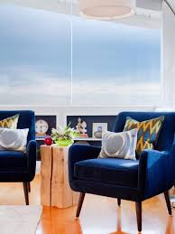 modern sitting area with blue velvet chairs