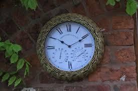 outdoor indoor garden wall clock wicker surround 15 inch aged clock face