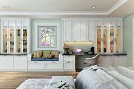 white shaker wall unit with window seat and glass cabinet doors in master bedroom
