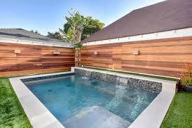 home swimming pools. Swimming Pool With Twin Waterfalls Home Pools