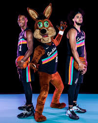 A brown leather pair of cowboy boots with spurs sits on rock in a field of texas bluebonnets. San Antonio Spurs Debut New Fiesta Jerseys With Court To Match Artslut