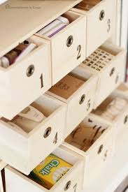 numbered wooden drawers storing stamps chalk tags hole punchers