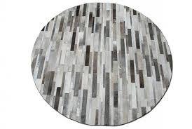 round taupe gray cowhide patchwork rug in stripes