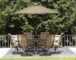 brown patio umbrella with pavers floor and dining set for patio decoration ideas
