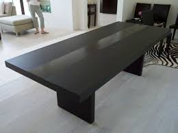 dinning room modern dining table with a black table with a minimalist design and a