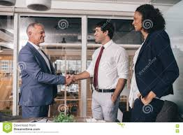 The Office The Merger Shaking Hands To A Successful Merger Stock Photo Image Of Inside