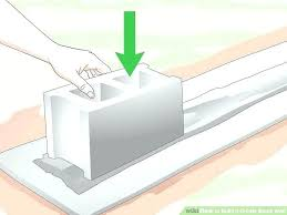build a retaining wall with cinder blocks building a cinder block retaining wall without mortar image