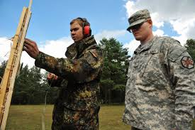 u s department of defense photo essay u s army pvt william roebuck right reviews his targets a german army