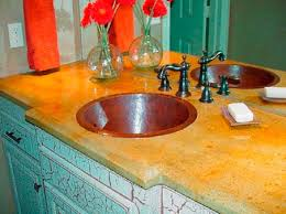 round copper sink in bathroom concrete countertop with iron colored fixtures le finish cabinetry
