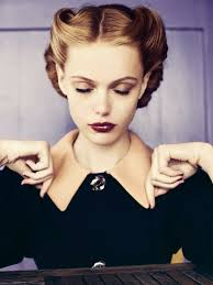 woman with 1940 s updo make up and closed eyes maa eye shadow dark red 140