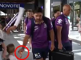 Watch as NRL star Brandon Smith is caught stealing lollipop from a toddler  leaving tot in tears
