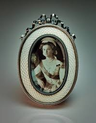 an antique white opal guilloche enamel and silver miniature picture frame by faberge made in st petersburg between 1908 and 1917 height 2 7 8 in 7 3 cm