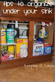 simple tips to help organize under your kitchen sink organization keepingitsimple share your craft kitchen sink organization