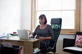 working for home office. Mature Pregnant Woman Working In Home Office For