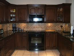 Kitchen Color Schemes With Black Appliances And Dark Brown Cabinet