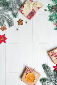 Gifts Background Christmas Congratulation Background With Gifts Pine Branches And Christmas Ornaments On The Wooden
