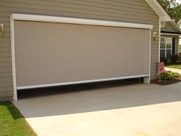 garage door screens retractablePhantom Privacy Screen on Large Garage  Retracta Screen of the