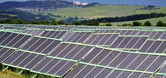 how arguments on solar power affect public support in the us and  solar park in the foreground a landscape hills in the background