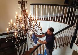 cleaning an entryway chandelier 960x675
