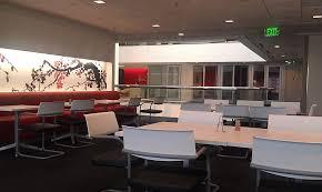 hitachi consulting. sitting area (break area) outside of atrium by kitchen - hitachi consulting dallas