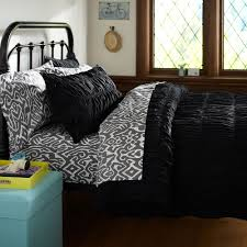 black ruched duvet cover with wooden floor and