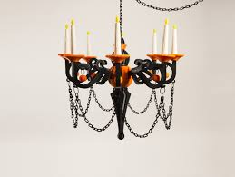 the chandelier of fear includes 70 parts flames 8 candles 8 candle cups 8 arms 8 center top 1 middle small 1 middle large 1 bottom big 1