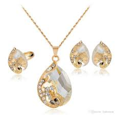 2019 gold plated white clear crystal rhinestone peacock teardrop crystal necklace rings and earrings jewelry set from fashionest 2 62 dhgate com