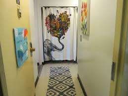 i used a shower curtain and rod to cover up the closet i also added a runner on the floor and art on the wall