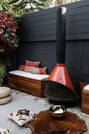 diy outdoor patio is complete renovation to transform the backyard into a built in bench with stovepipe fireplace previously this angle into the garbage