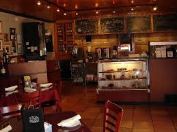 Tolla's Italian Deli Cafe: Tolla's facing toward the counter and kitchen ...