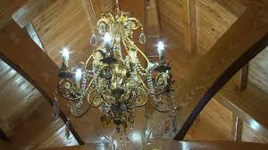 a collection of chandeliers hang throughout the stone jug s three floors bruce tilley cbc