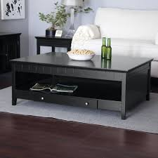large dark wood coffee table with drawers