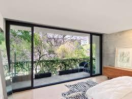 wide modern sliding glass door designs for bedrooms