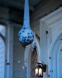 Super creepy Halloween DIY decoration: How to make hanging spider egg sacs  at Martha Stewart