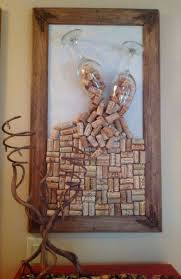 Look at the wine holder! Home-made cork board made with collected corks and  old frame and used some nice big wine glasses to have corks spilling out of  them ...