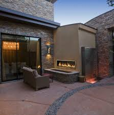 town and country outdoor linear fireplace in an outdoor living room setting