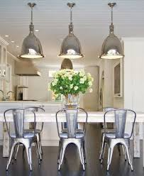 metal dining room chairs chrome: metal tolix chairs with chrome light fixtures east hamptons beach house