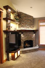 Fireplace build complete with stacked stone finish and wooden shelving