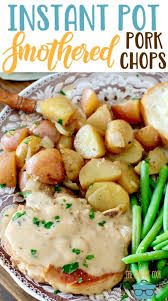 Tender pork chops cooked in the instant pot & smothered with a creamy ranch sauce. Instant Pot Smothered Pork Chops The Country Cook