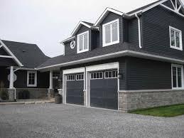 gray house black garage door design color dark