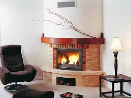 wood burning corner fireplace with panoramic glass rondo by cheminees seguin
