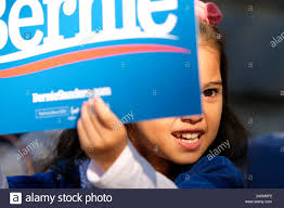 October 19, 2019, Queens, New York, United States: Bernie Sanders supporter  shows her enthusiasm as he