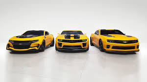 Фановский transformers 4 teaser poster. Bumblebee Camaros From Transformers Head To Barrett Jackson Scottsdale