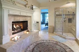 luxury bathroom suite with large fireplace and glass shower enclosure