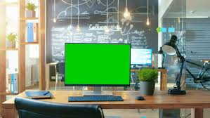 creative office desk. Personal Computer With Mock-up Green Screen Monitor Stands On The Office Desk, In Creative Desk L